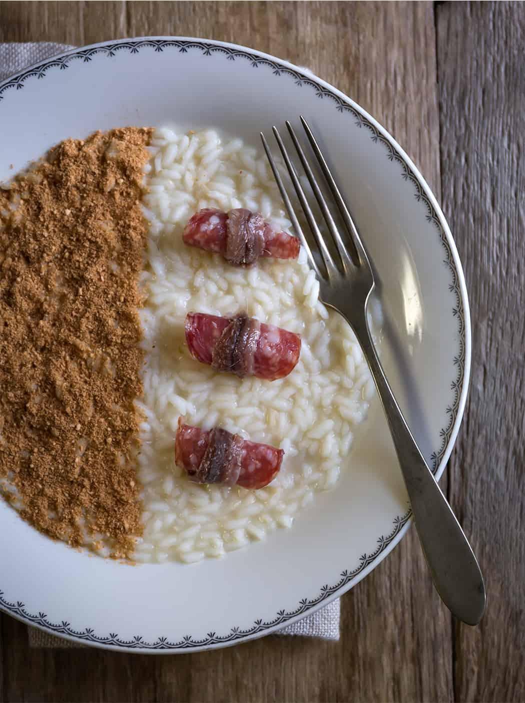 ricetta risotto con acciughe pane e salame