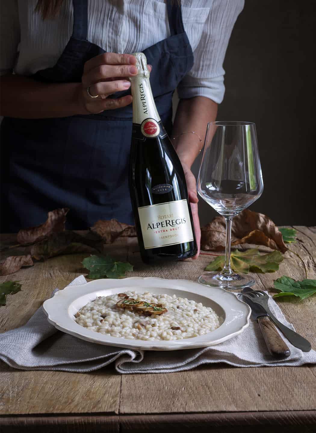 risotto con funghi e Rotari spumante Alperegis